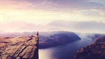 Create a Photo Manipulation of a Woman Watching a Sunrise Landscape