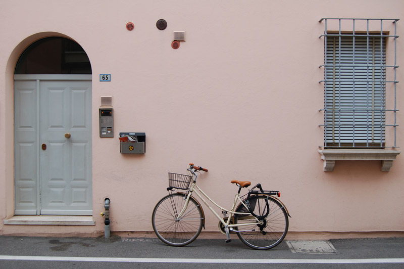 A bike leaning against a wall